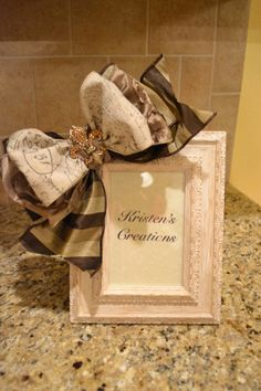 French Script Ribbon Frame by kristenscreations on Etsy, $30.00.  I like frames embellished with pretty ribbon!
