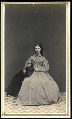 J.P. Vail, Seated woman with large black dog, 1875