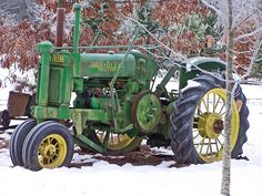 old john deere in snow
