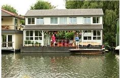 We lived on the houseboat to the left of this one in the pic - Taggs Island, on River Thames, London