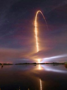 Space shuttle launch at night.