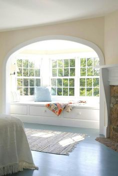 The arch, the fireplace, instead of a window seat I want a tub!