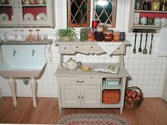 Pat's miniatures - Quilters' house  triangular lace doily under fruit jars on shelf