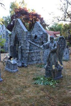 Demon angel and new mausoleum in the background.  Davis Graveyard 2012