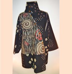 This three-quarter medium-weight jacket by Cupcake International is styled for the woman with fashion-forward tastes. The high neck has two handmade buttons that allow it to be worn up or flat or whatever. Thailand is famous for its high-quality fabrics, and this hand-blocked design exceeds all expectations.