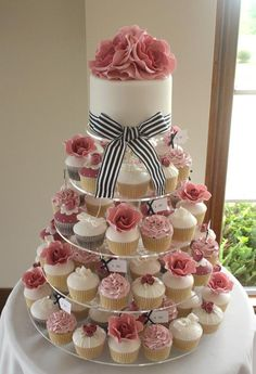 Cupcakes are fun! But this is great idea because you still have a wedding cake for your 1 year anniversary. Purple Wedding Cakes, Wedding Cakes With Cupcakes, Wedding Cakes With Flowers, Elegant Wedding Cakes, Elegant Cakes, Wedding Cake Designs, Cupcake Cakes, Flower Cakes, Gold Wedding
