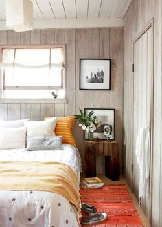 soothing beach house with worn wood paneled walls