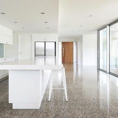 Polished Concrete floor, wood door, white. Home Design, Decorating, and Renovation Ideas on Houzz Australia