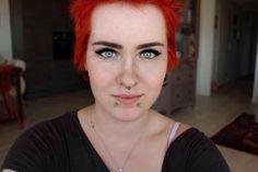 #snakebites #snakebite #piercing #facepiercing #bodymodification #art #bodyart #expression #emo #emotional #punk #punkrock #rock #redhair #red #shorthair #goth #gothic #eyebrows #fleek #septum #nosepiercing #lippiercing #lip #nose #eyeliner #black #mascara #lashes #jewelry #facejewelry #blueeyes #blue #eyes #shiny