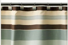 Blue and brown shower curtains.