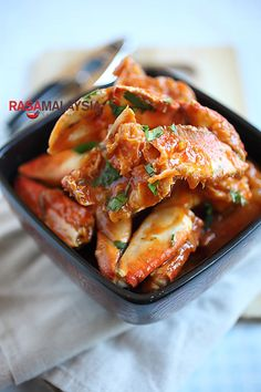 Chili Crab (Crab in Sour and Spicy Sauce) recipe - This rendition with the eggy, sweet, sour, and spicy sauce is perfect for entertaining guests or simply when you want to have a crab feast. Try it with steamed buns to sop up the leftover sauce! #singapore #malaysian #crab