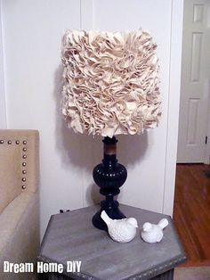I like the lampshade.  It must be done similiar to these types of wreaths.
