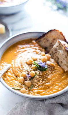 Easy to pull together with pantry ingredients, this Tomato Chickpea Soup is garlicky, and rich with just a hint of rosemary! Share it creamy or chunky with a sprinkle of parm. This recipe is vegetarian, easily vegan and gluten free. Quick Soup Recipes, Easy Chicken Recipes, Vegetarian Recipes, Vegan Soups, Beef Recipes, Cod Recipes, Ramen Recipes, Chickpea Recipes, Vegetarian Cooking