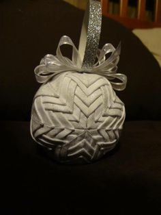 http://quilting.about.com/od/holidayquiltpatterns/ss/folded-fabric-star.htm  http://www.theornamentgirl.com/quilted-ornaments.htm