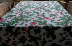 """Vintage Christmas Tablecloth Red Decorations Green Evergreen Boughs with Red Berries 46"""" X 108"""". $26.95, via Etsy."""