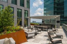 Photo of VITA - McLean, VA, United States. Meet up with neighbors for a little outdoor grilling or relax with guests around the fireplace. Granite Suppliers, Sky Bar, Black Granite, Rooftop Terrace, Outdoor Furniture Sets, Outdoor Decor, Building Materials, White Marble, Home Projects