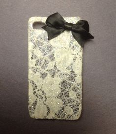 Lace IPhone 4 Case. I don't know. I like this.  maybe more lush lace and a bigger bow, in, like, ecru satin, but I think my iphone needs a lace dress.