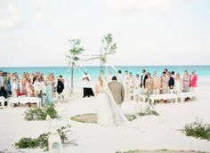 Photography: KT Merry - ktmerry.com   Read More on SMP: http://www.stylemepretty.com/2015/01/06/coral-bahamas-destination-wedding/