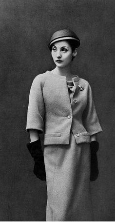 1957 Renée Breton in light blue wool dress under short jacket by Christian Dior