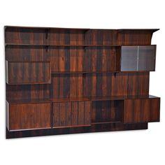 CADO Four-bay rosewood shelving system - Price Estimate: $3000 - $5000