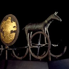 The Trundholm sun chariot (Danish: Solvognen), is a late Nordic Bronze Age artifact discovered in Denmark. It is a representation of the sun chariot, a bronze statue of a horse and a large bronze disk, which are placed on a device with spoked wheels.  The sculpture was discovered with no accompanying objects in 1902 in a peat bog on the Trundholm moor in West Zealand.