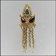 Earring Date: mid-1st century Culture: Sarmatian Medium: Gold, garnets, green glass Dimensions: Overall: 1 3/4 x 9/16 x 3/8 in. (4.5 x 1.4 x 1 cm) Classification: Metalwork-Gold Credit Line: Rogers Fund, 1922