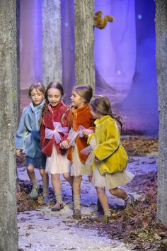 four bright fun fur jackets from the magical forest catwalk of Il Gufo at Pitti Bimbo 80 for fall15 kids fashion
