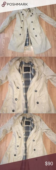 """Zara trench coat Zara classic trench coat with belt, quilted with flannel on the inside which is detachable. Great for layering or dressing up for a night out 👠. I'm 5'3"""" and pictured show how it fits. It's a size small but could fit a medium which I am. 🙂 PRICE IS FIRM Zara Jackets & Coats Trench Coats"""