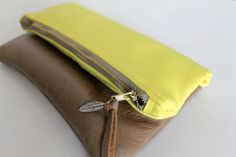 Yellow canvas and leather fold over clutch by Amayahandmade, $40.00