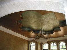 Metallic turquoise cloverleaf ceiling.