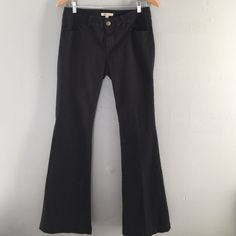 CAbi Black Flare Jeans CAbi flares in black stretch denim. Excellent preloved condition. No rips, stains, or fraying on hems. CAbi Jeans Flare & Wide Leg