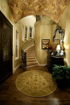 Small foyer with hidden staircase wrapping around and behind the foyer wall.