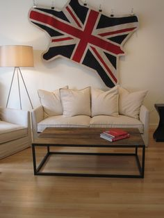 Jonathan Adler rug and G. Romano slipcovered Axis sofa at Cottage Industry - Winter 2012