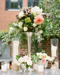 """Sidra Formanfilled both tall and short votives withfeminine, organic arrangements, which linedthe altar and dottedguest's tables. """"I wanted a Virginia garden feel. Beautiful, but with a sense of untamed wildness,"""" said the bride."""
