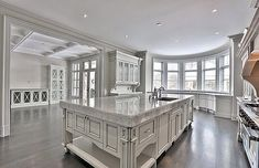 Right off the bat, I have fallen in love with the natural light streaming through these windows and the bright white gorgeous cabinetry. Home, Mansion Kitchen, House Rooms, Luxury Kitchens, House Design, Elegant Kitchens, New Homes, Dream Kitchens Design, Luxury Kitchen Design