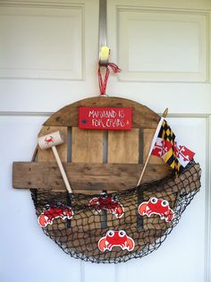 Maryland Wreath for front door. I used a crab basket top as the base.