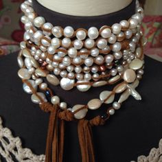 A personal favorite from my Etsy shop https://www.etsy.com/listing/249944602/sale-classic-pearl-and-suede-lariat-a