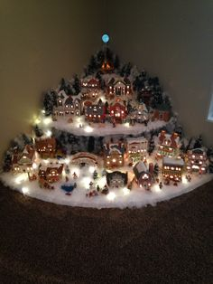 me ~ Love Christmas villages! So pretty and eye catching! Christmas Tree Village Display, Corner Christmas Tree, Christmas Candle Decorations, Christmas Villages, Lemax Christmas Village, Miniature Christmas, Christmas Minis, Christmas Projects, Christmas Holidays
