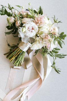 romantic blush wedding fllowers with ribbons