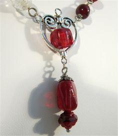"Red ""rosary bead"" necklace. $18.00, via Etsy."