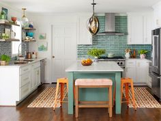This smart kitchen renovation from HGTV Magazine has lots of ideas to steal. Big Kitchen, Smart Kitchen, Little Kitchen, White Kitchen Cabinets, Make Kitchen Look Bigger, Kitchen White, Kitchen Dinning, Dark Cabinets, Rustic Kitchen