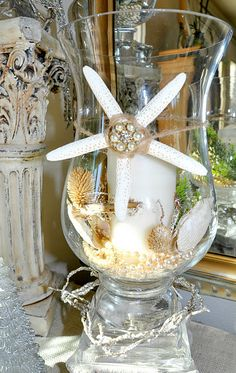 Candle in hurricane with shells and a beautiful starfish....