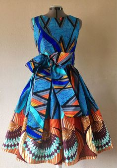 Cute little summer dress that would be perfect for a day at the museum or strutting the city. It is made from mixed African Wax print cotton. Dress includes pockets, Sash, zips in the back. Each item Best African Dresses, Latest African Fashion Dresses, African Print Dresses, African Attire, African Wear, African Outfits, Best African Dress Designs, African Prints, African American Fashion