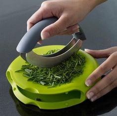 Enjoying this compact herb chopper. Great way to add some fresh herbs to your Idaho Spuds!