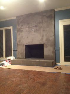 DIY Concrete Fireplace Tutorial by Designer Trapped in a Lawyer's Body {www.designertrapped.com}