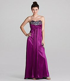 Dillards: From Masquerade, this strapless beaded dress features: strapless sweetheart bustline multi-colored beads decorate bodice criss-cross banding at empire waist cutout at low back long sateen body $89.40