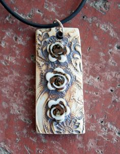 Rustic+Flower+Trio+Porcelain+Pendant+by+muddyfingers+on+Etsy To try with Polymer