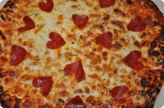 Easy Valentine's Day at home.  Take a Frozen Pizza and cut the peperoni into hearts= Done.