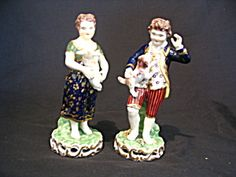 Pair Old Porcelain Statues