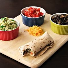 Vegetarian burrito with rice, beans, and tomatoes.